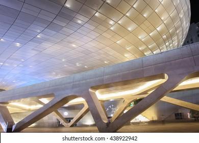 SEOUL, SOUTH KOREA -  SEPTEMBER 27, 2015: Dongdaemun Design Plaza at Night, New development in Seoul, designed by Zaha Hadid. Photo taken september 27, 2015 in Seoul, South Korea.