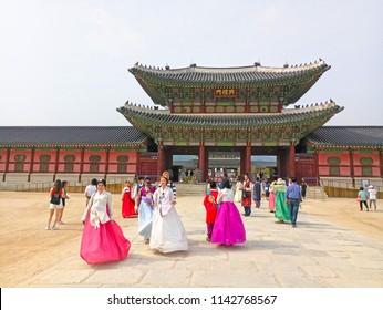 Seoul, South Korea-July10, 2018 : Asian Korean woman dressed Hanbok in traditional dress walking in Gyeongbokgung Palace