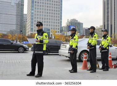 SEOUL, SOUTH KOREA-NOVEMBER 11; Policemen in front of the American Embassy watching the traffic. November 11, 2015 Seoul, South Korea