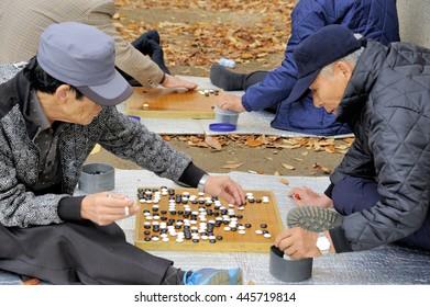 SEOUL, SOUTH KOREA-NOVEMBER 15: Men playing in the outside Baduk that is the Korean name for Go. November 15, 2015 Seoul, South Korea