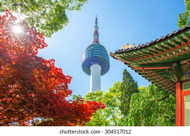 Seoul Tower with gyeongbokgung roof and red autumn maple leaves at Namsan mountain in South Korea.