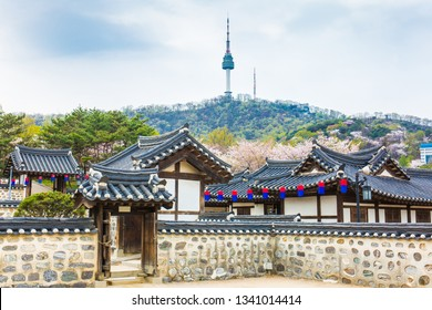 Seoul tower and Namsangol Hanok Village in spring season with pink cherry Blossom ,Seoul, South Korea