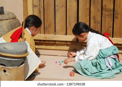 Seoul/Korea - April 28, 2007 : Korean traditional children's play with five or more small round stones or plastic