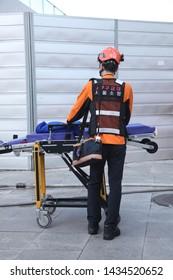 "Seoul/Korea - May 2, 2019 : A Korean paramedic on the scene (Korean text is ""119 Emergency Battalion Seoul Fire Department"")"