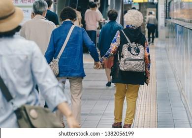 Seoul/Republic of Korea - June 11, 2017: Two senior ladies walking hand in hand, Elderly couple, same sex couple, two women, senior woman back view