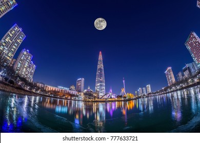 SEOUL,SOUTH KOREA - 17 DECEMBER 2017 : Full moon at Lotte world and Ice reflection in Seoul city,South Korea