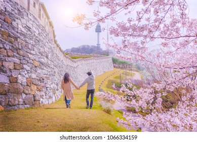 Seoul,South Korea - 7 April 2018 : Young people walking together to watch cherry blossom at namsan park and seoul tower in south korea.