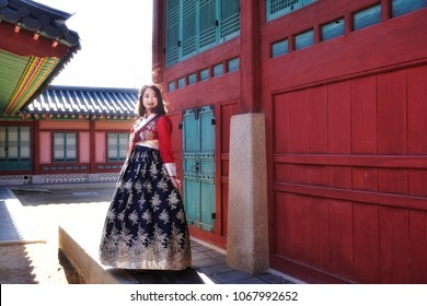 Seoul,South Korea - DEC 01 - 2016 : The traveller posture in Hanbok traditional Korean clothes in autumn winter at the Gyeongbokgung Palace.