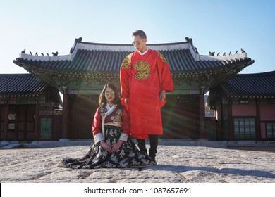 Seoul,South Korea - DEC 01 - 2016 : The Couple love traveller posture in traditional Korean clothes in autumn winter at the Gyeongbokgung Palace.