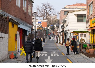 SEOUL,SOUTH KOREA - DEC 29, 2017 : Unidentified people visit Bukchon Hanok Village in Seoul,South Korea on December 29,2017. Bukchon Hanok Village is preserved to show a 600-year-old urban environment