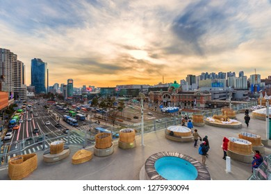 Seoul,South Korea -December 31, 2018: People visit and tour at Seoullo 7017 Botanical Skyline park ,Sunrise and viewpoint of Seoul Station Square and  traffic in Seoul, South Korea.