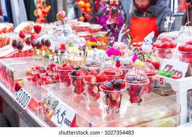 SEOUL,SOUTH KOREA - FEBRUARY 16,2018: Fresh Strawberry in the plastic cup at myeong dong street Seoul,South Korea