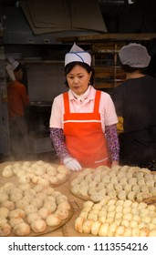 SEOUL-SOUTH KOREA, MAY 17, 2018: Woman selling dumpling in a food stand in Namdaemun Market in South Korea, the oldest and largest market in Korea