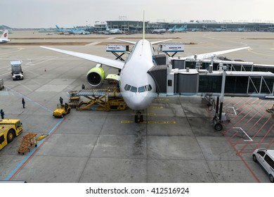 Seoul,South Korea-Jan 6,2016:Airport officials are carrying the load for the aircraft at  Incheon International Airport in South Korea.