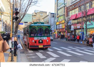 SEOUL,SOUTH KOREA-JANUARY 3 ,2017: Seoul City Tour Bus at Hongdae Shopping Street in the evening