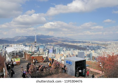 SEOUL,SOUTH KOREA-NOVEMBER 12,2015:Thousands of colorful love locks at an observation point at the Namsan Hill (or Namsan Park or Namsan Mountain) and view of the city in Seoul, South Korea.