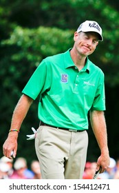 Sep 15, 2013; Lake Forest, IL, USA; Jim Furyk reacts after missing a putt on the 18th green during the third round of the BMW Championship at Conway Farms Golf Club.
