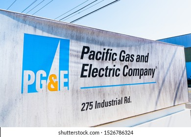 Sep 19, 2019 San Carlos / CA / USA - Dirty PG&E sign at one of their offices in San Francisco Bay Area; Power lines visible overhead
