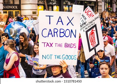 Sep 20, 2019 San Francisco / CA / USA - Tax carbon placard raised at the Global Climate Strike Rally and March in downtown San Francisco;
