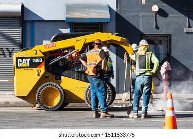 Sep 20, 2019 San Francisco / CA / USA - CAT skid steer with Jackhammer attachment, breaking the concrete on a street in SOMA District