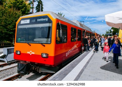 SEP 22, 2013 Zurich, Switzerland - Uetliberg train with many tourists on platform at Mt. Uetliberg station, starting point of walking trail to Torre Top of Zurich tower.