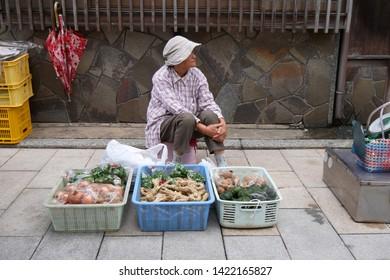 SEP 22, 2018 SAGA, JAPAN : Farmer sell her organic vegetables at Yobuko Morning Market Street, Karatsu City, Saga, JAPAN