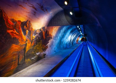 SEP 24, 2013 Jungfrau, Switzerland - Alpine sensation exhibition and wall art of Jungfrau exploring story at Jungfraujoch station underground tunnel with escalator walk way