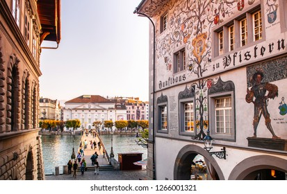 SEP 24, 2013 Luzern, Switzerland - Tourists on Rathaussteg bridge and old vintage buildings in Lucerne medieval old town area