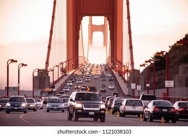 SEP 26, 2009 San Francisco, USA - Traffic on San Francisco Golden Gate bridge on foggy day dramatic evening light