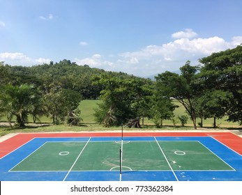 Sepak-takraw court (Sport which is famous in Indonesia) with trees and blue sky background.