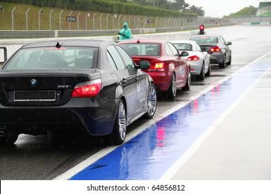 SEPANG - CIRCA MAY 2010: Anonymous BMW car owners test drive their cars at Sepang race track, Malaysia, during a rainy HPC track day circa May 2010.
