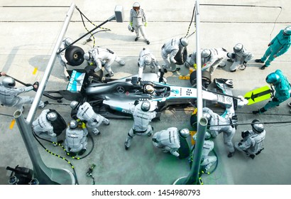 SEPANG, MALAYSIA, 30 March 2014: Driver Mercedes AMG Petronas F1, Lewis Hamilton, entering crews does pit-stop practice at the 2014, F1 Petronas Malaysian Grand Prix at Sepang International Circuit
