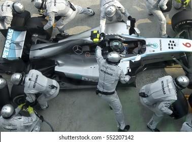 SEPANG, MALAYSIA, 30 March 2014: Driver Mercedes AMG Petronas F1, Nico Rosberg, entering crews does pit-stop practice at the 2014,F1 Petronas Malaysian Grand Prix at Sepang International Circuit