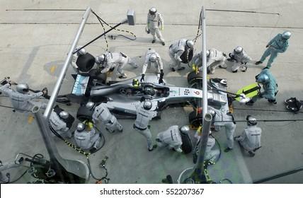 SEPANG, MALAYSIA, 30 March 2014: Driver Mercedes AMG Petronas F1, Nico Rosberg, entering crews does pit-stop practice at the 2014, F1 Petronas Malaysian Grand Prix at Sepang International Circuit