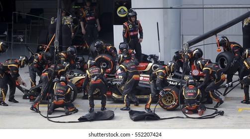 SEPANG, MALAYSIA, 30 March 2014: Driver Lotus F1 Team entering crews does pit-stop at the 2014, F1 Petronas Malaysian Grand Prix at Sepang International Circuit.