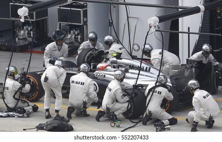 SEPANG, MALAYSIA, 30 March 2014: McLaren Mercedes entering crews does pit-stop at the 2014, F1 Petronas Malaysian Grand Prix at Sepang International Circuit.