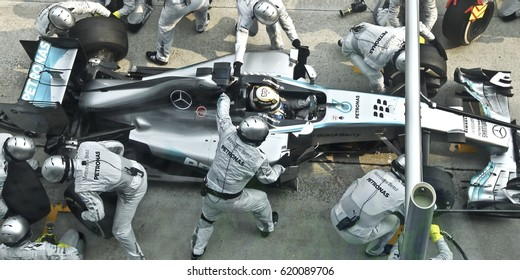 SEPANG, MALAYSIA, 30 March 2014: Driver Mercedes AMG Petronas F1, Nico Rosberg, entering crews does pit-stop practice at the 2014, F1 Petronas Malaysian Grand Prix at Sepang International Circuit.