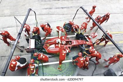SEPANG, MALAYSIA - 30 March 2014: Ferrari Team driver, Fernando Alonso, entering crews does pit-stop practice at the 2014, F1 Petronas Malaysian Grand Prix at Sepang International Circuit.