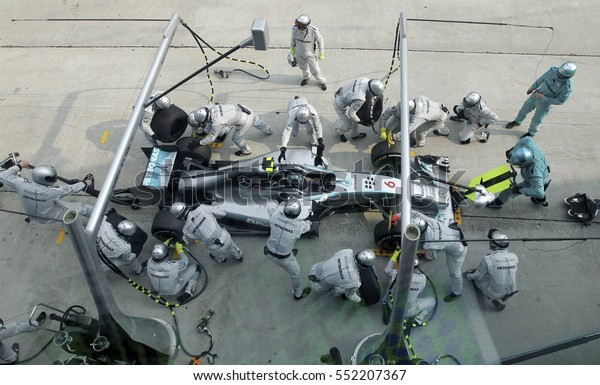 SEPANG, MALAYSIA, 30 March 2014: Driver Mercedes AMG Petronas F1, Nico Rosberg, entering crews does pit-stop practice at the 2014, F1 Petronas Malaysian Grand Prix at Sepang International Circuit