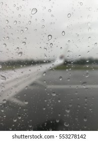 SEPANG, MALAYSIA - 31 DECEMBER, 2016: Raindrop on the window of Malaysia Airline flight while take off from Kuala Lumpur International Airport (KLIA) to Kuching, Sarawak, Malaysia.