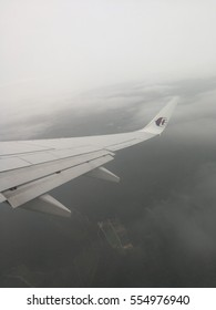 SEPANG, MALAYSIA - 31 DECEMBER, 2016: Misty view from window of Malaysia Airline flight from Kuala Lumpur International Airport (KLIA) to Kuching, Sarawak, Malaysia.
