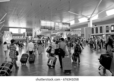 SEPANG, MALAYSIA - APR 7, 2016: Passengers in the KLIA2 departure hall in Sepang, Malaysia. KLIA2 is the world's largest purpose-built terminal dedicated to low-cost carriers.