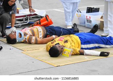 SEPANG, MALAYSIA - APRIL 10, 2008: Volunteers were seen on the grounds of the terminal fire scene during an emergency training at the Kuala Lumpur International Airport (KLIA) in Sepang, Malaysia.