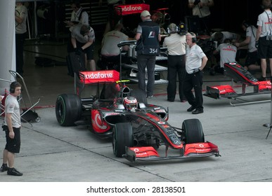 SEPANG, MALAYSIA - APRIL 3 : Heikki Kovalainen of Vodafone McLaren Mercedes exits pit garage during practice session at Malaysian F1 Grand Prix April 3, 2009 at Sepang International Circuit in Sepang.