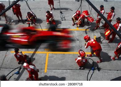 SEPANG, MALAYSIA - APRIL 4: Scuderia Ferrari Marlboro crews does pit-stop practice at the 2009 F1 Petronas Malaysian Grand Prix April 4, 2009 in Sepang Malaysia.