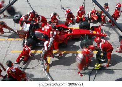 SEPANG, MALAYSIA - APRIL 4: Scuderia Ferrari Marlboro crews do pit-stop practice at the 2009 F1 Petronas Malaysian Grand Prix April 4, 2009 in Sepang Malaysia.
