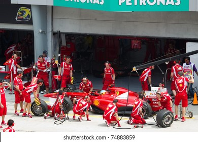 SEPANG, MALAYSIA - APRIL 8: Spanish Fernando Alonso of Scuderia Ferrari having a trial pitstop during Friday practice at Petronas Formula 1 Grand Prix on April 8, 2011 in Sepang, Malaysia