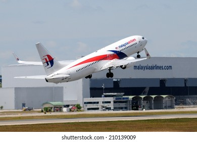 SEPANG, MALAYSIA - AUGUST 5: Malaysia Airline plane Boeing 737-800, Registration name 9M-MXI, take-off at KLIA airport on August 5, 2014 in KLIA, Sepang, Malaysia.