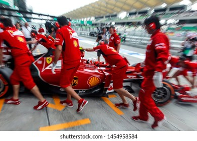 SEPANG, MALAYSIA :  Crew Ferrari Team push the car Kimi Haikkonen, before during the practice session of F1, Petronas Malaysia Grand Prix at Sepang International Circuit on March, 29, 2014