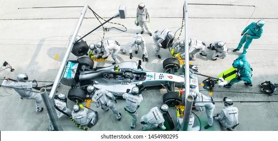 SEPANG, MALAYSIA : Driver Mercedes AMG Petronas F1, Nico Rosberg, entering crews does pit-stop practice at the 2014, F1 Petronas Malaysian Grand Prix at Sepang International Circuit on March 30, 2014